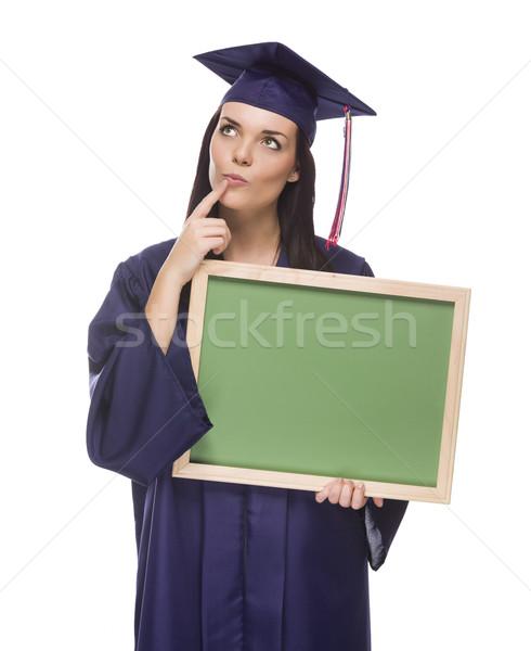 Denken vrouwelijke afgestudeerde cap toga Stockfoto © feverpitch