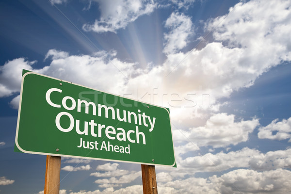 Community Outreach Green Road Sign Over Clouds Stock photo © feverpitch