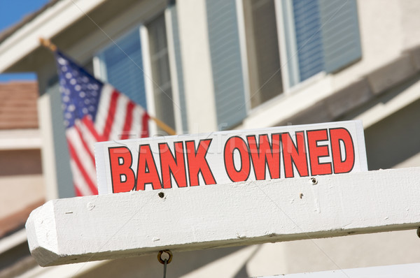 Bank Owned Real Estate Sign and House with American Flag Stock photo © feverpitch