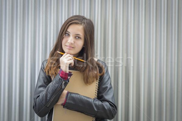 Jovem melancolia feminino estudante livros olhando Foto stock © feverpitch