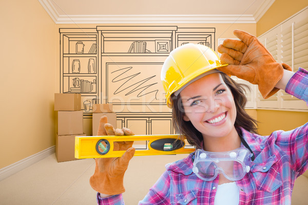 Female Construction Worker Holding Level In Front of Custom Buil Stock photo © feverpitch