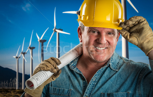 Smiling Contractor in Hard Hat Holding Extention Cord Outdoors N Stock photo © feverpitch