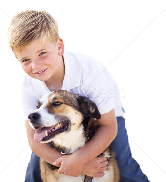 Handsome Young Boy Playing with His Dog Isolated Stock photo © feverpitch