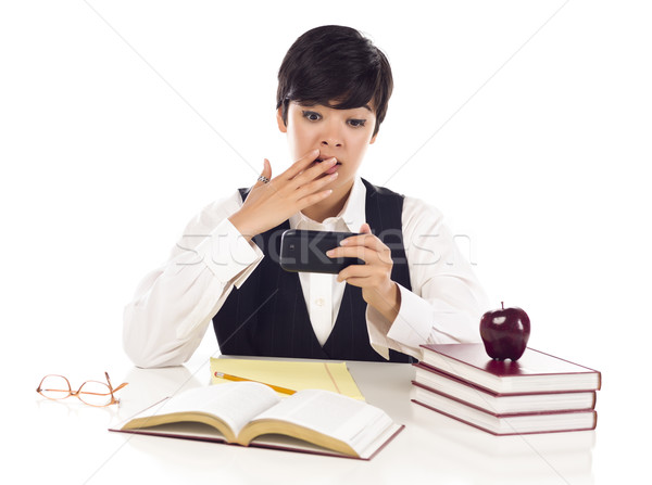 Pretty Mixed Race Female Student Shocked at Cell Phone Message Stock photo © feverpitch