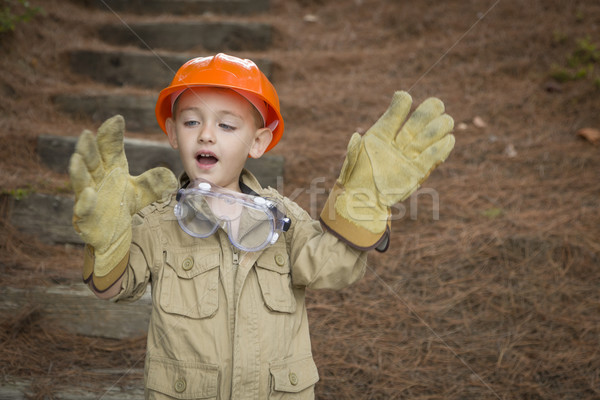 Adorable Child Boy with Big Gloves Playing Handyman Outside Stock photo © feverpitch