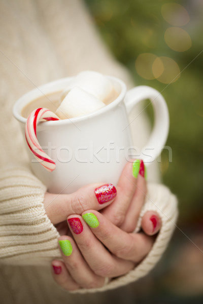 Woman with Red and Green Nail Polish Holding Cup of Stock photo © feverpitch
