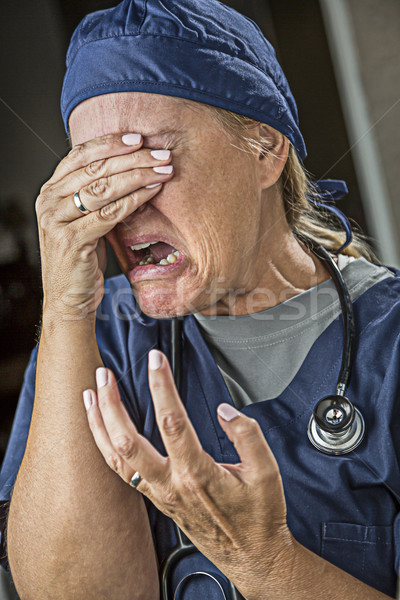 Agonizing Crying Female Doctor or Nurse Stock photo © feverpitch
