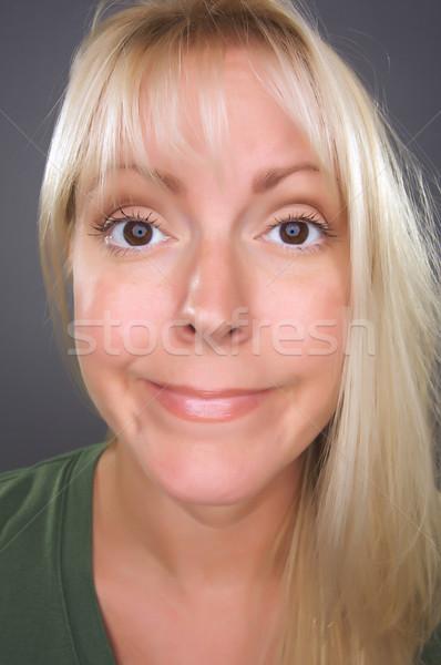 Stock fotó: Gyönyörű · szőke · nő · vicces · arc · szürke · lány