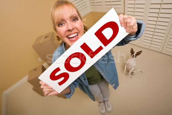 Woman and Doggy with Sold Sign Near Moving Boxes Stock photo © feverpitch