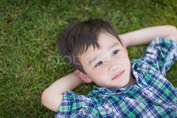 Thoughtful Mixed Race Chinese and Caucasian Young Boy Relaxing O Stock photo © feverpitch