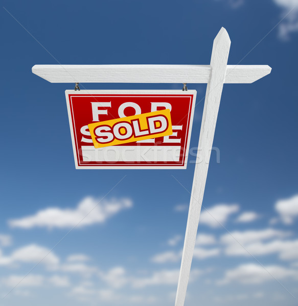 Left Facing Sold For Sale Real Estate Sign on a Blue Sky with Cl Stock photo © feverpitch