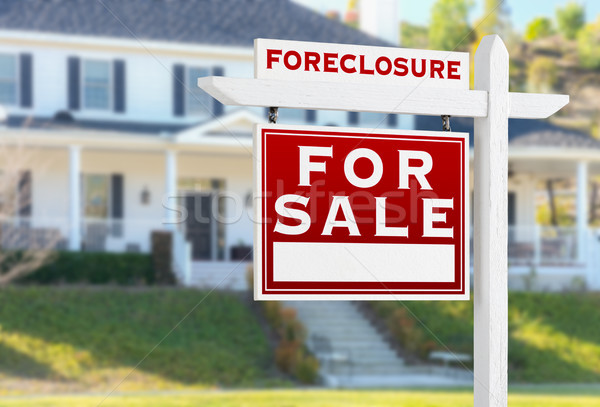 Left Facing Foreclosure For Sale Real Estate Sign in Front of Ho Stock photo © feverpitch