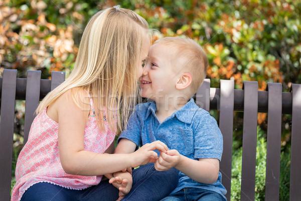 Jovem irmã irmão banco parque Foto stock © feverpitch