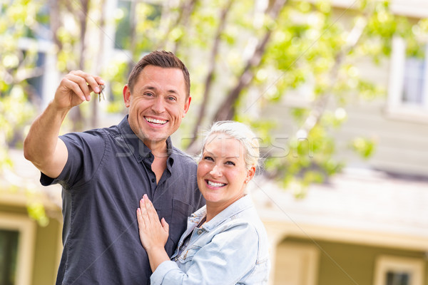Caucasian Couple in Front of House with Keys Stock photo © feverpitch
