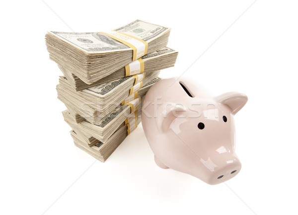 Pink Piggy Bank with Stacks of Money Stock photo © feverpitch