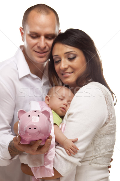 Young Mixed Race Parents with Baby Holding Piggy Bank Stock photo © feverpitch