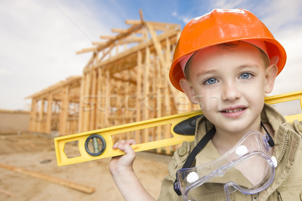 Stock photo: Child Boy Dressed Up as Handyman in Front of House Framing