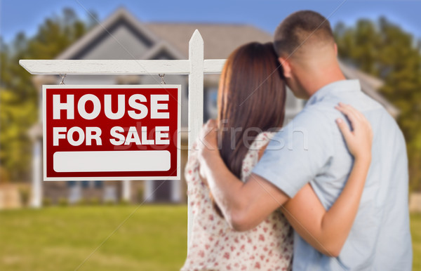 For Sale Real Estate Sign, Military Couple Looking at House Stock photo © feverpitch