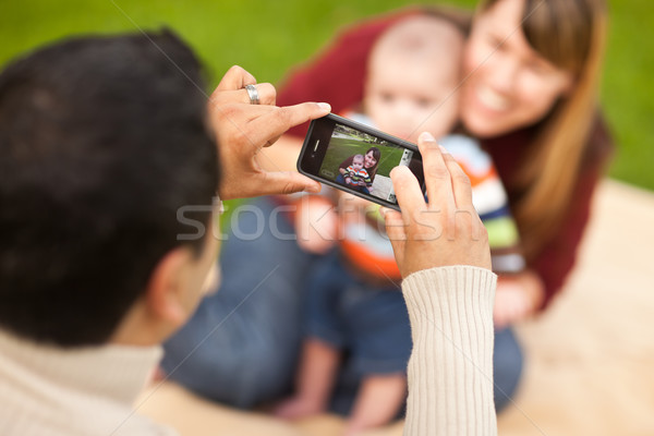 Happy Mixed Race Parents and Baby Boy Taking Self Portraits Stock photo © feverpitch