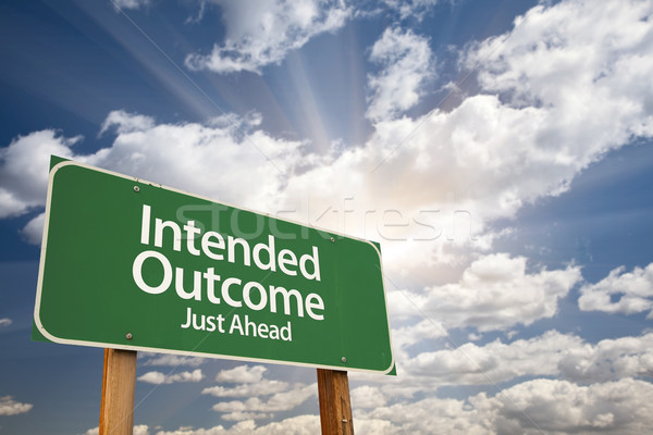 Intended Outcome Green Road Sign Over Clouds Stock photo © feverpitch