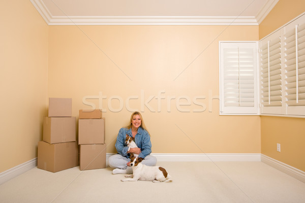 Pretty Woman and Dogs with Moving Boxes in Room on Floor Stock photo © feverpitch