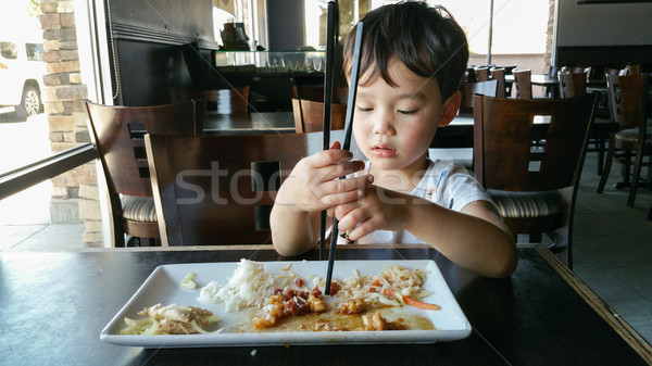Cute Young Chinese and Caucasian Boy Learning To Use Chopsticks  Stock photo © feverpitch