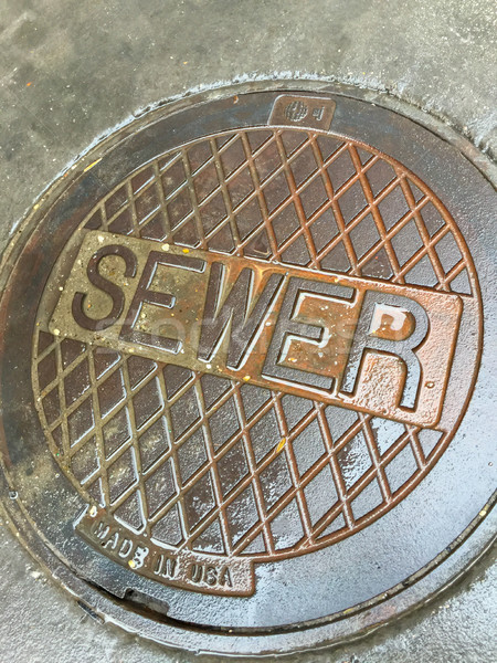 Industrial Wet Sewer Street Drain Cover Stock photo © feverpitch