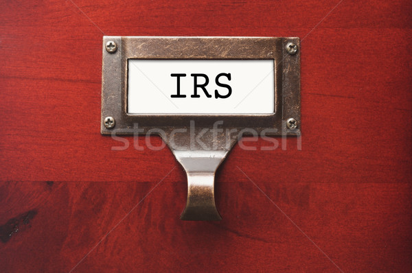 Lustrous Wooden Cabinet with I.R.S. File Label Stock photo © feverpitch