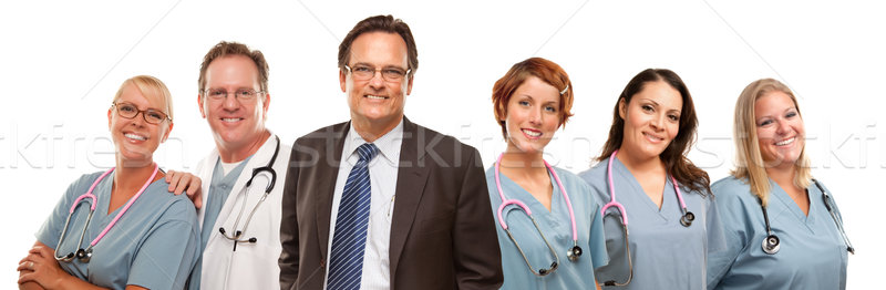Friendly Male and Female Doctors with Businessman on White  Stock photo © feverpitch