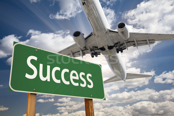 Stock photo: Success Green Road Sign and Airplane Above