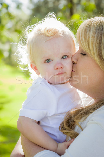 Stock photo: Young Mother Holding Her Adorable Baby Boy