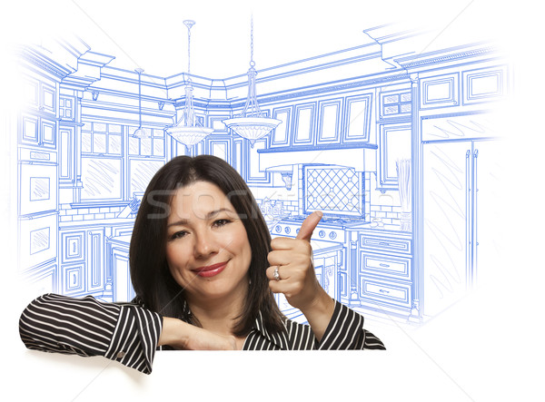 Hispanic Woman with Thumbs Up, Custom Kitchen Drawing Behind Stock photo © feverpitch