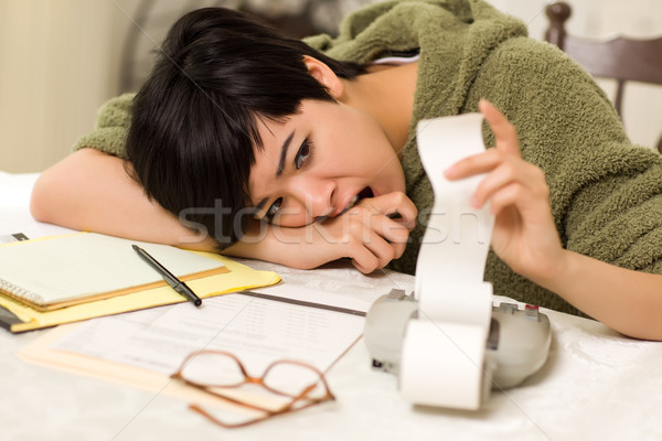 Stock photo: Multi-ethnic Young Woman Agonizing Over Financial Calculations