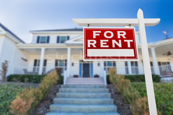 Left Facing For Rent Real Estate Sign In Front of House. Stock photo © feverpitch