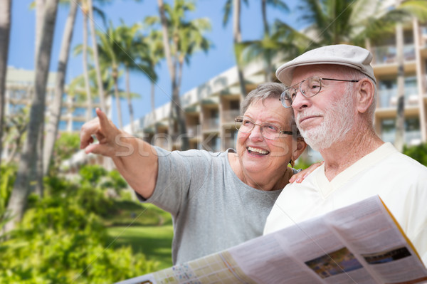 Happy Senior Adult Couple Tourists with Brochure Next To Tropica Stock photo © feverpitch