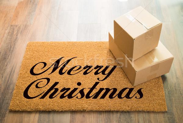 Alegre natal bem-vindo piso de madeira expedição caixas Foto stock © feverpitch