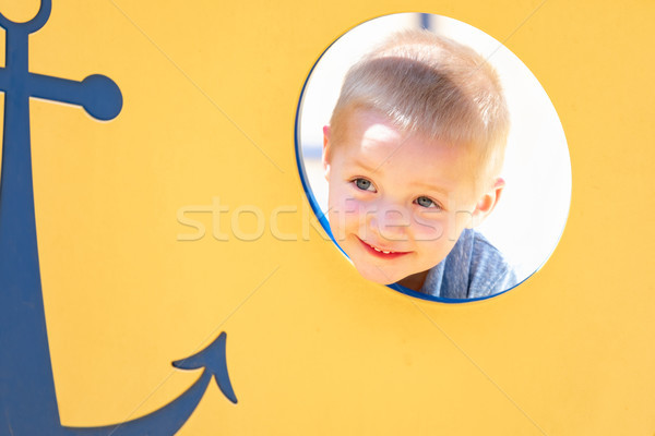 Happy Young Boy Having Fun At The Playground Stock photo © feverpitch