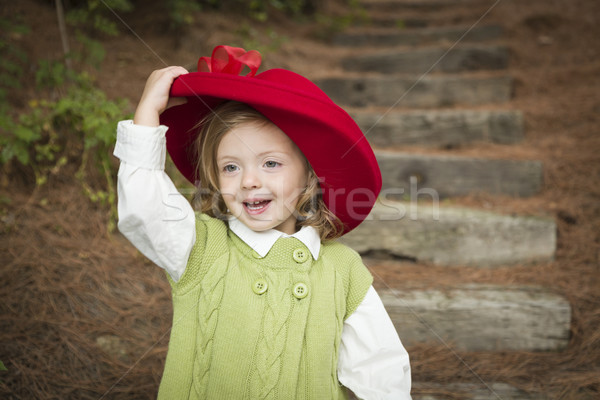 Adorable Child Girl with Red Hat Playing Outside Stock photo © feverpitch