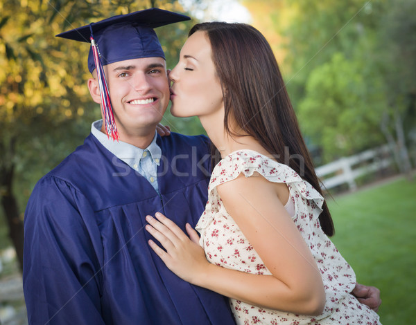 Male Graduate in Cap and Gown and Girl Celebrate Stock photo © feverpitch