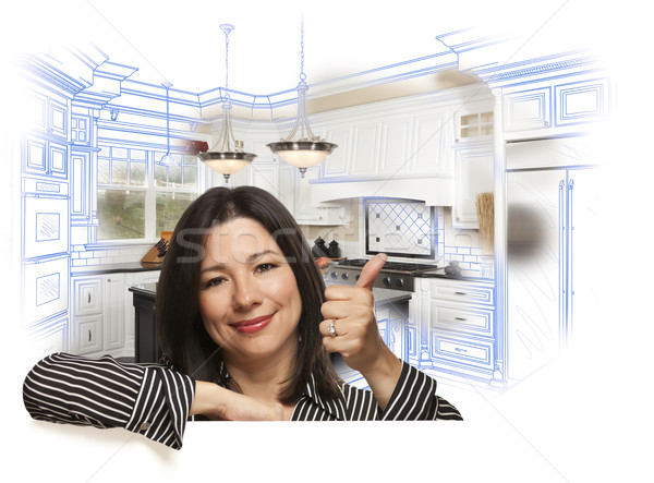 Hispanic Woman with Thumbs Up, Kitchen Drawing and Photo Behind Stock photo © feverpitch