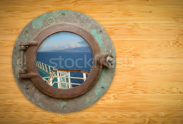 Antique Porthole on Bamboo Wall with View of Ship Deck Railing a Stock photo © feverpitch
