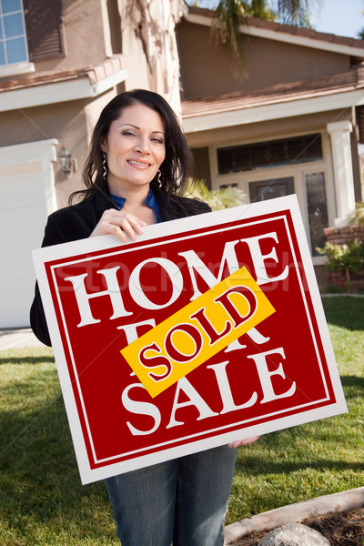 Hispanic Woman Holding Red Sold Real Estate Sign In Front of Hou Stock photo © feverpitch