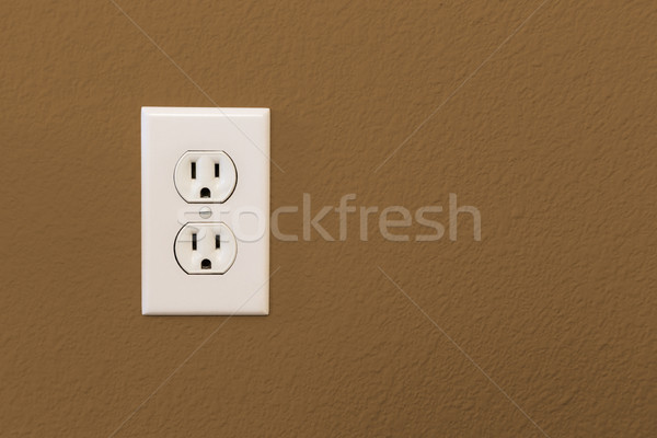 Electrical Sockets In Colorful Brown Wall Stock photo © feverpitch