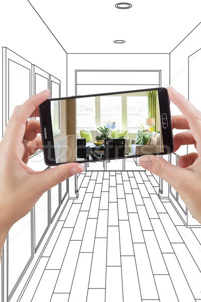 Hands Holding Smart Phone Displaying Photo of House Hallway Draw Stock photo © feverpitch
