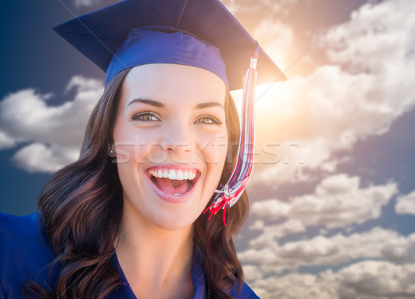 Happy Graduating Mixed Race Woman In Cap and Gown Stock photo © feverpitch