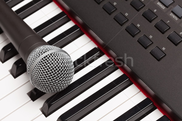 Microphone Laying on Electronic Synthesizer Keyboard Abstract Stock photo © feverpitch