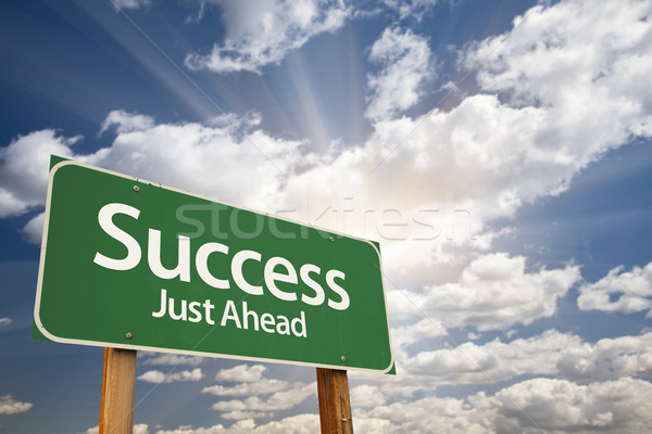 Success Green Road Sign Against Clouds Stock photo © feverpitch