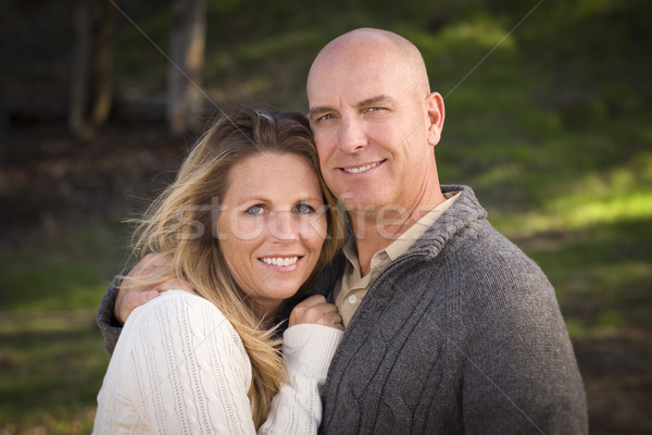 Attractive Couple Wearing Sweaters in Park Stock photo © feverpitch