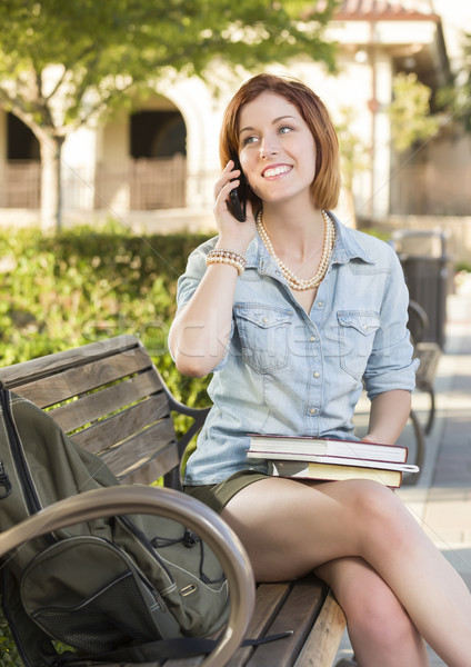Stock photo: Young Female Student Outside Using Cell Phone Sitting on Bench