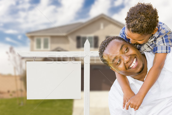 African American Father and Mixed Race Son In Front of Blank Real Estate Sign and House Stock photo © feverpitch